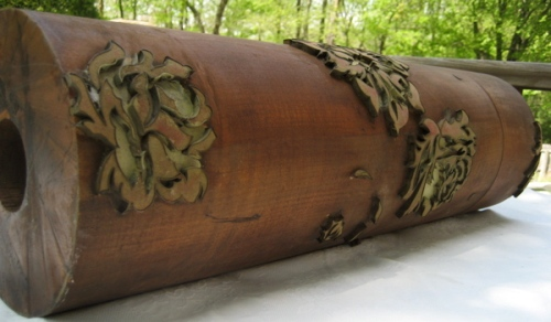 This is an antique wooden roller for printing wallpaper